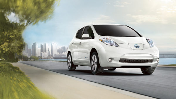 2016 Nissan Leaf electric car pearl white exterior driving down street