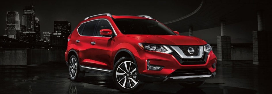 The 2019 Nissan Rogue with a city skyline in the back round