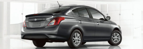 Gray 2019 Nissan Versa parked in a showroom.
