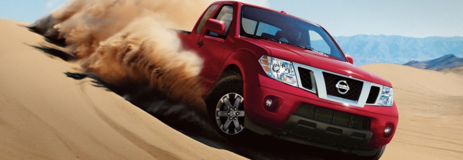 2019 Nissan Frontier driving through desert