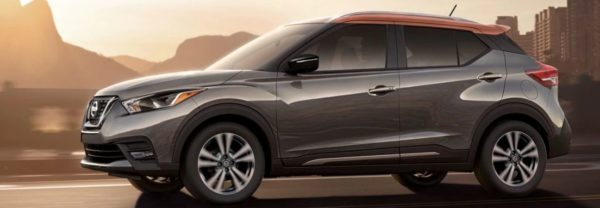 2019 nissan kicks driving at sunset